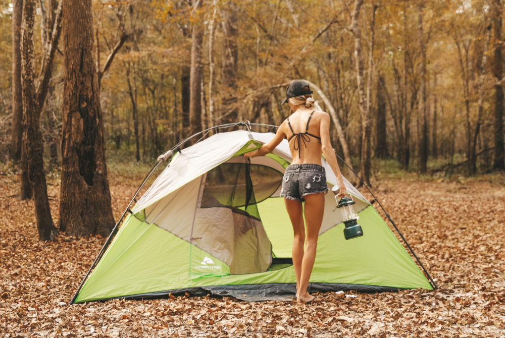 Woman exits a tent in the fall weather at Ginnie Springs.