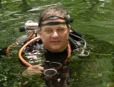 Image of Reggie, a dive instructor at Ginnie Springs in the water in scuba gear
