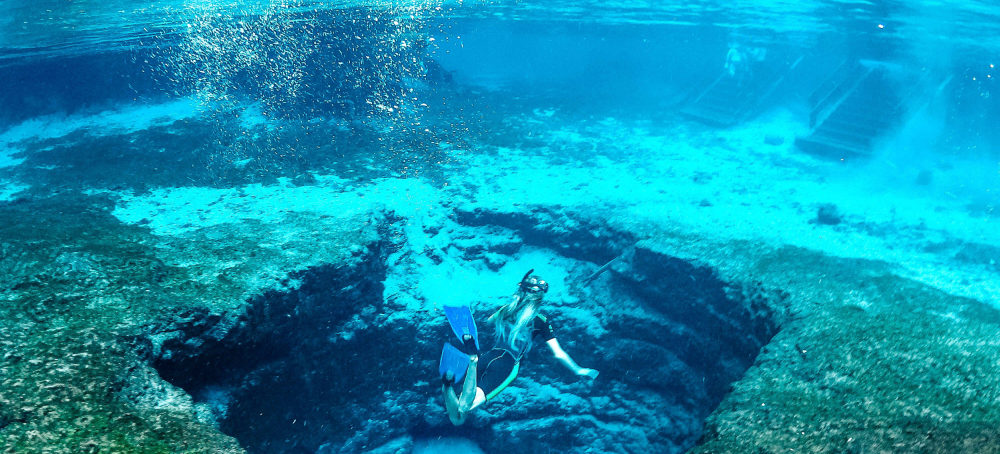 Image of a girl snorkeling in Devil's Eye Spring at Ginnie Springs.